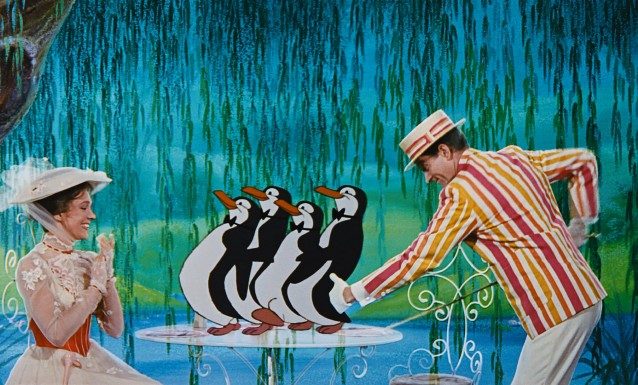 Mary Poppins (Julie Andrews) and her friend Bert (Dick Van Dyke) are delighted to be waited on by penguins on their trip inside a chalk drawing.
