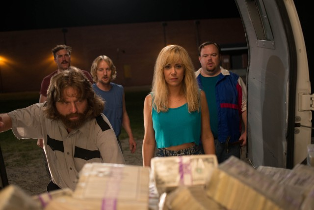 "David Ghantt (Zach Galifianakis) shows off the fruits of his labors, an armored truck holding $17 million in cash to Kelly Campbell (Kristen Wiig) and friends in ""Masterminds."""