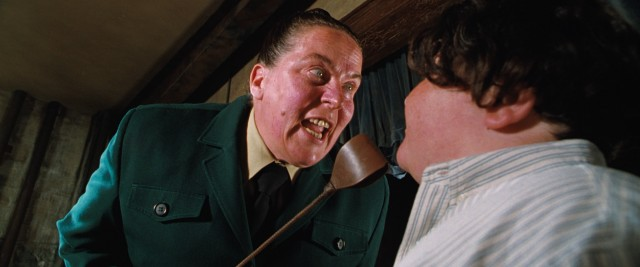 Trunchbull (Pam Ferris) insists that Bruce Bogtrotter eat the entirety of a giant chocolate cake.