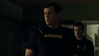 "Christopher Blake (Michael Paré) is calling the shots this Friday night and his vest should read ""Mercenary"" instead of ""Marshal."""