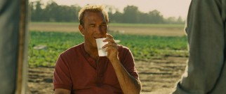 Coach White (Kevin Costner) develops a further appreciation for his boys after joining them for a typical day of back-breaking field labor.