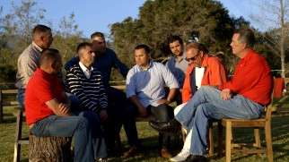 "Members of the actual 1987 McFarland cross country team sit down for a scenic outdoor chat with Coach White and Kevin Costner in ""McFarland Reflections."""