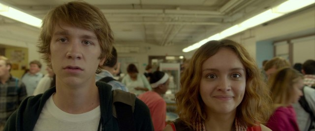 Greg (Thomas Mann) and Rachel (Olivia Cooke) take in the sights of their high school's narrow cafeteria.