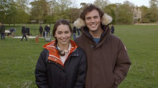 "Emilia Clarke and Sam Claflin stay warm on the set in ""'Me Before You': From Page to Screen."""