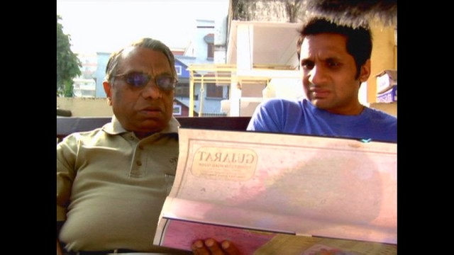 "Vasant Patel uses a map to show his son Ravi the areas of India where Patels come from in ""Meet the Patels."""