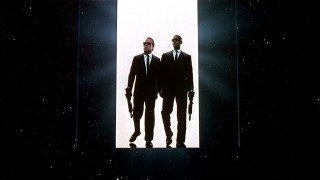 "Agents K and J bust open a door that becomes the I in the ""Men in Black"" trailer's MIB logo."