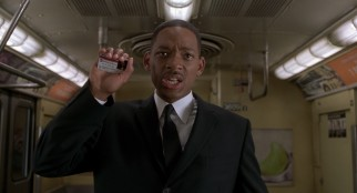 Agent J (Will Smith) identifies himself as an MTA official in the opening action sequence in which a giant worm chases a subway train.