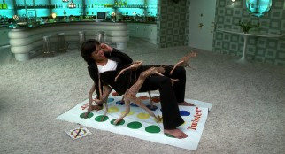 Important witness Laura Vasquez (Rosario Dawson) plays a game of Twister with the worm guys.