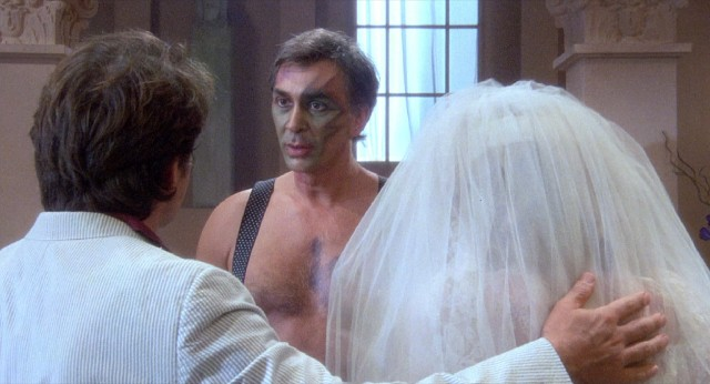 "His face colorfully painted by a prostitute, Harold Canterbury (Frank Langella) proceeds to marry Solly and his hooker in the inane finale of ""The Men's Club."""
