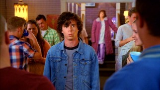 Parental embarrassment is afoot for Axl (Charlie McDermott) at a friend's high school graduation party.