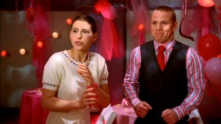 Sue (Eden Sher) and Darrin (John Gammon) make an unlikely but genuine couple at their high school's Valentine's Day dance.