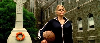 Immaculata College's new head coach Cathy Rush (Carla Gugino) awaits her players with the school's one basketball at her side.