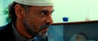 Miral's protective father (Alexander Siddig) discourages her from doing anything that could get her into trouble.
