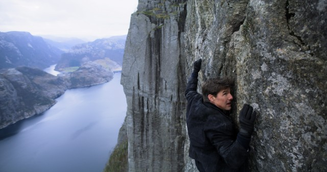 "Ethan Hunt (Tom Cruise) clings to a cliff in Kashmir in the overlong climax of ""Mission: Impossible - Fallout."""