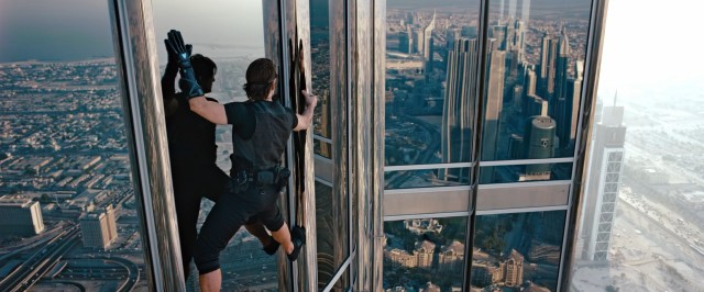 Doing his own death-defying stunt, Tom Cruise climbs along the side of Dubai's Burj Khalifa, the world's tallest building.
