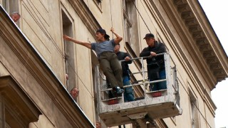 "A casual Tom Cruise rehearses the first of his elevated wire stunts in ""Suiting Up in Prague."""