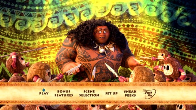Maui is surrounded by spear-wielding coconut creatures on the colorful Moana DVD main menu.