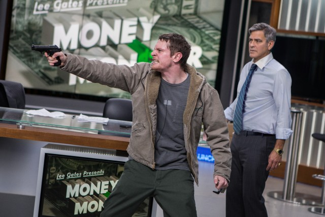 "In ""Money Monster"", a TV show host (George Clooney) finds his show taken over by an irate young man with a gun (Jack O'Connell)."