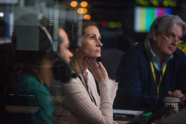 "Patty (Julia Roberts) keeps her cool in the booth, directing ""Money Monster"" as a televised hostage situation."
