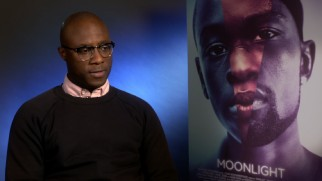 "Screenwriter-director Barry Jenkins discusses ""Moonlight"" next to the film's creative poster art."