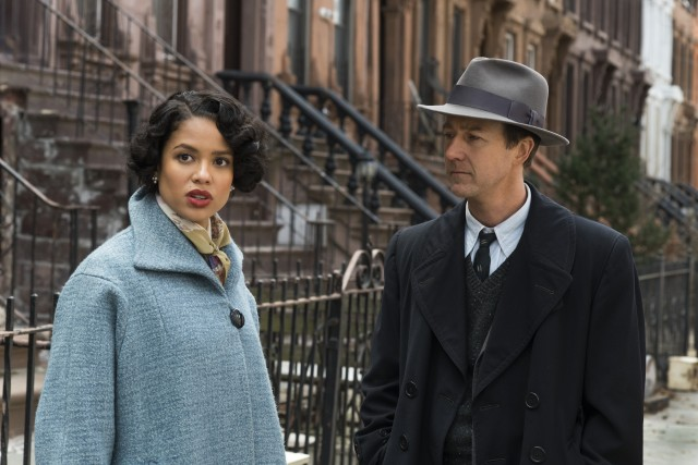 "Private eye Lionel Essrog (Edward Norton) poses as a journalist to get close to Laura Rose (Gugu Mbatha-Raw) in ""Motherless Brooklyn."""