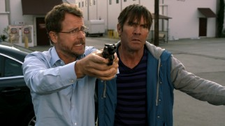Griffin (Greg Kinnear) turns the gun Charlie (Dennis Quaid) pointed at him on his boss in a late stretch of frame story.