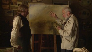 "Mike Leigh directs Timothy Spall at a canvas in ""The Many Colours of Mr. Turner."""