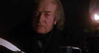 "Michael Caine plays the stingy miser Ebenezer Scrooge in ""The Muppet Christmas Carol."""