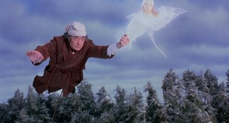 The Ghost of Christmas Past leads Scrooge (Michael Caine) on a flight through time.