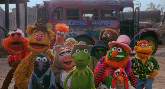 The Muppets stand by Kermit the Frog as he stands up to Doc Hopper.