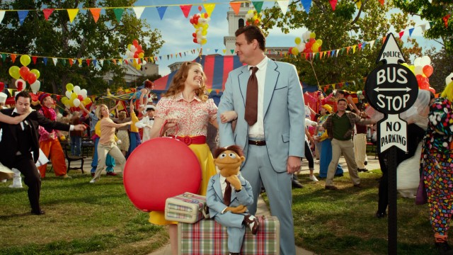 Life's a happy song for L.A.-bound Smalltown, USA residents Mary (Amy Adams), Gary (Jason Segel), and Walter as this colorful opening number illustrates.