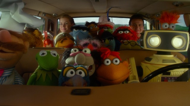 Sharing one tight car, the Muppets reunite with some montage and map driving.
