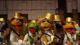 "The Muppet gang opens the film with the candid, self-reflexive song ""We're Doing a Sequel."""