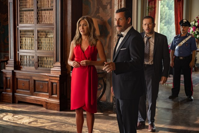 "Audrey (Jennifer Aniston) and Nick Spitz (Adam Sandler) find themselves suspected of multiple murders on their European vacation in ""Murder Mystery."""