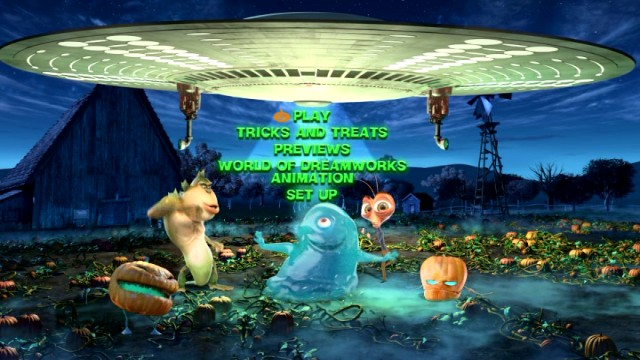 The main menu finds the human-sized monsters and mutant pumpkins engaging in spirited dance.