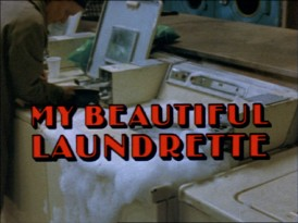 "Soap spills out of a washing machine in Orion's US trailer for ""My Beautiful Laundrette."""