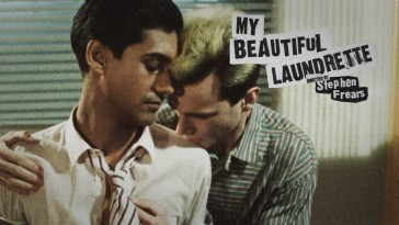 Omo and Johnny share an embrace on the My Beautiful Laundrette Blu-ray top menu.
