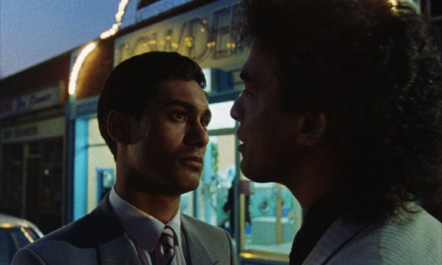 Omar Ali (Gordon Warnecke) rises from parking lot car cleaner to proprietor of a refurbished laundrette.