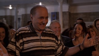 Though he has misgivings at first, Gus Portokalos (Michael Constantine) comes to welcome his son-in-law with open arms.
