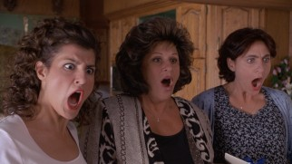 Something shocks the Portokalos women (Nia Vardalos, Lainie Kazan, and Bess Meisler).