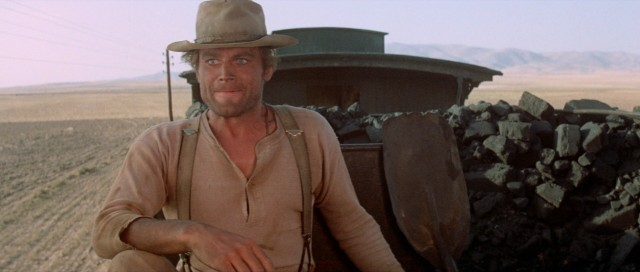 From a train providing protection, Nobody (Terence Hill) looks on and keeps score of his idol Beauregard's grand finale heroics.