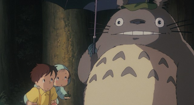 While awaiting their father at a rainy bus stop, Satuski and Mei lend an umbrella to the big Totoro who then makes the rain stop.