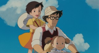 Mr. Kusakabe and his two daughters go for a bicycle ride in their new country neighborhood.