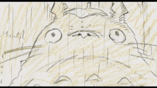 Totoro braves the rain with a leaf on his head in storyboard form.
