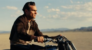 In the desert, Freddie Quell (Joaquin Phoenix) picks a point off in the distance and takes a fast motorcycle ride there and beyond.