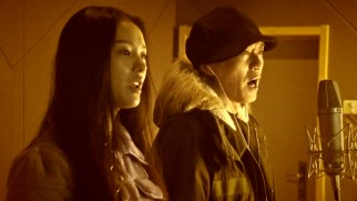 "The sepia-toned ""Invincible"" music video finds Jelly Lin and Deng Chao singing, whether or not it sounds like it."