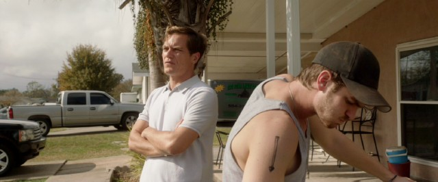 "In ""99 Homes"", Dennis (Andrew Garfield) has no better choice than to work for Rick Carver (Michael Shannon), the slimeball who evicted his family."