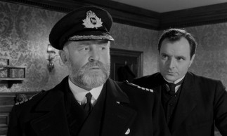 Captain Edward John Smith (Laurence Naismith) and Second Officer Charles Herbert Lightoller (Kenneth More) are not comforted by their calculations of the ship's anticipated damage.