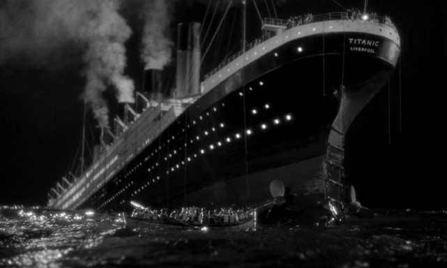 "Lifeboats get away from the sinking Titanic in one of the obvious miniature shots of ""A Night to Remember."""