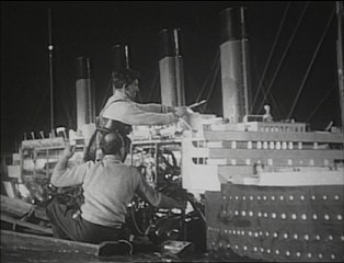 "Giant men work on the Titanic...or maybe ordinary-sized men work on a Titanic miniature in ""The Making of 'A Night to Remember.'"""